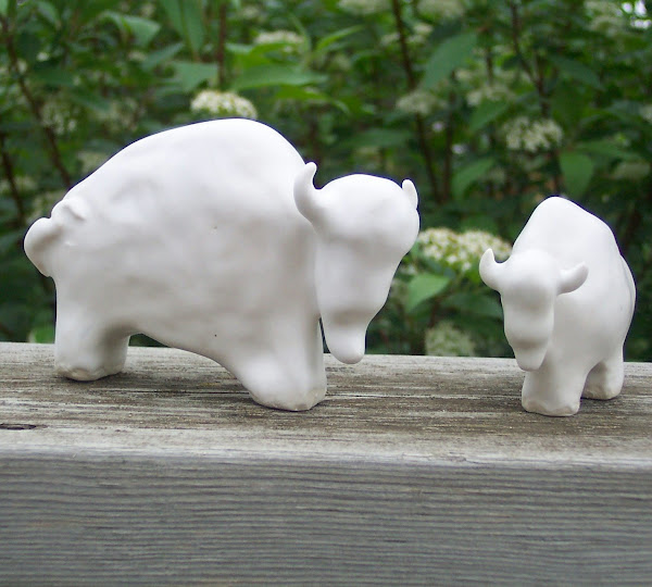 Ceramic, snow white bison mama and baby