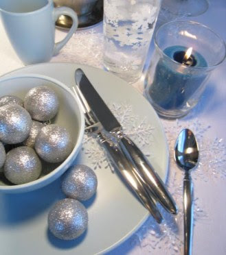 blue and silver winter themed table setting