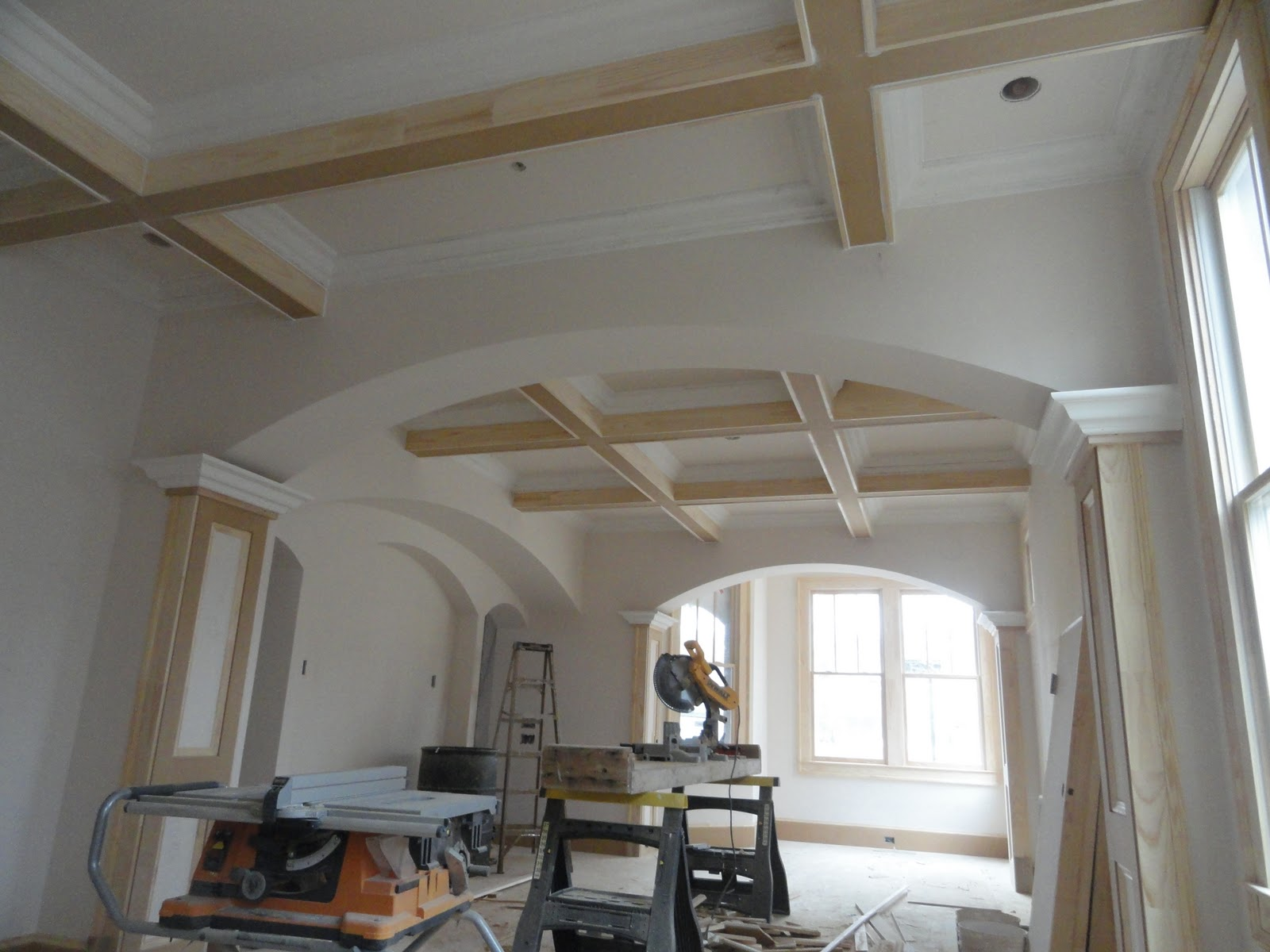 Coffered ceilings of formal living and dining rooms. title=