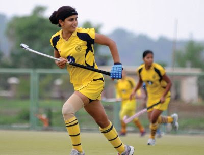 Hockey team star player Mamta Kharab (10) in action with other players