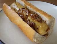 Beer Cooked Sausages and Onion in crusty rolls
