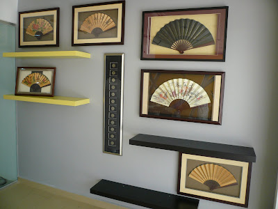 Grouping of frames of Chinese collectibles, fans and coins