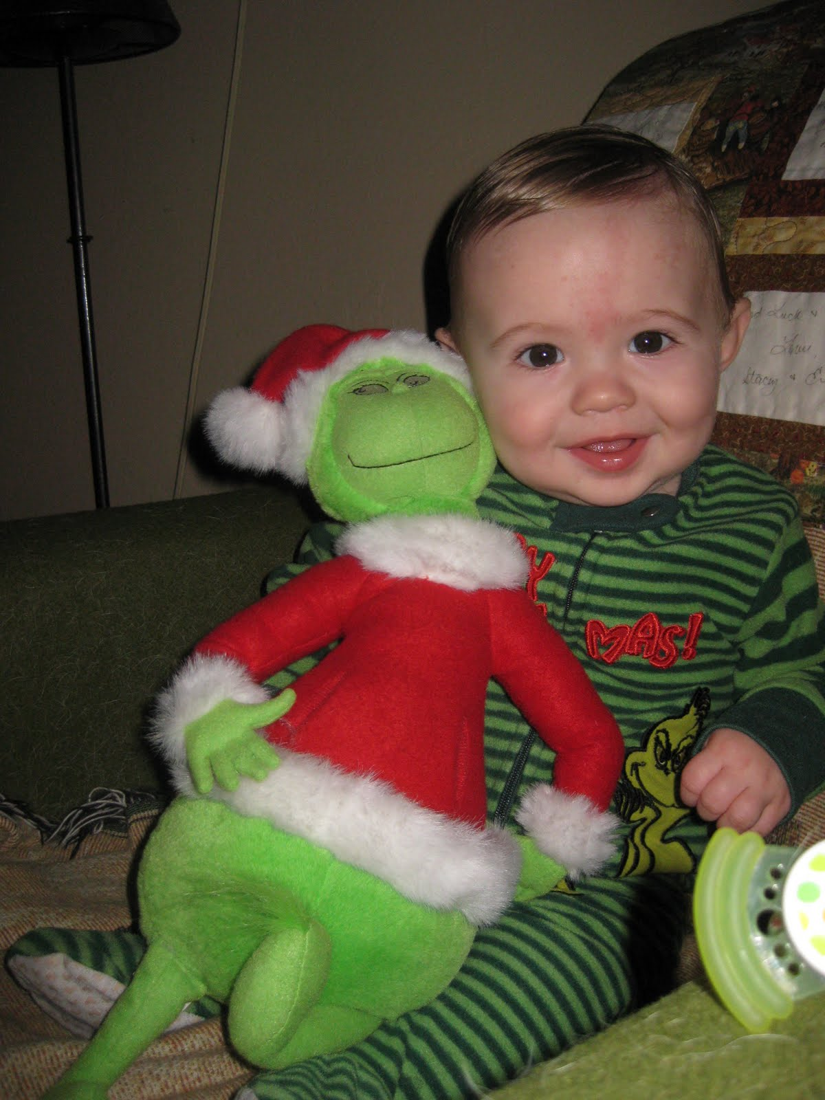 Baby Grinch Gif Has grinch pajamas for the