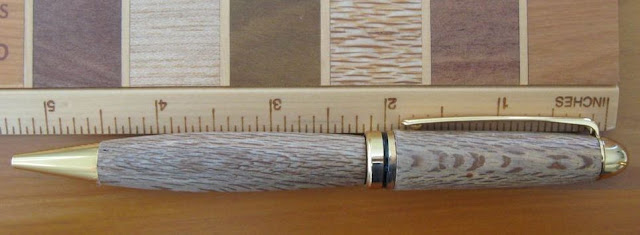 wooden ruler and pen