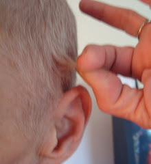 ALMOST touching the top of the ear!!