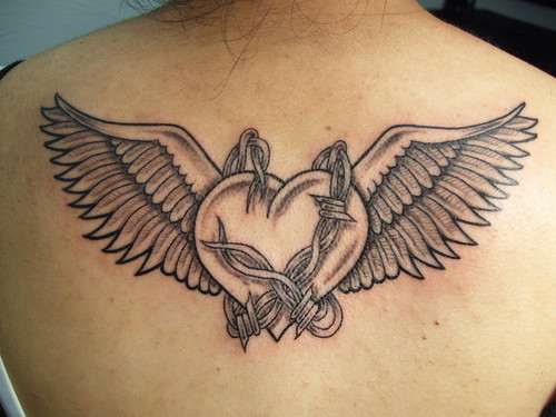 Posted in Custom Hearth With Wings And Barbwire Tattoo by designs