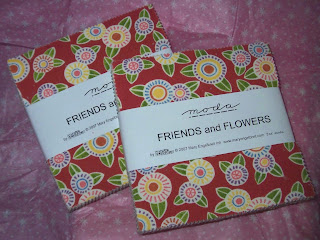 two packages containing five inch squares of the complete fabric line of Friends and Flowers