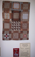 sampler quilt in browns