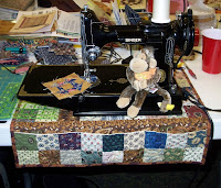 My Featherweight on the sewing mat I bought from Tazzie in Australia