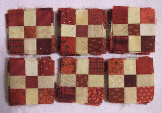 Eighty reds and creams nine patch blocks for the mystery quilt