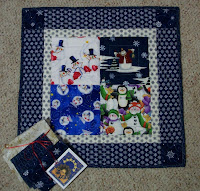 Little quilt with four squares of snowmen fabric