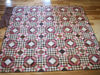 Connie's Carolina Crossroads Mystery quilt in pinks and browns