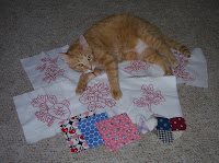 red work blocks, feed sack fabric, vintage hearts and Jasper in the middle of it all