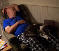 Dad sleeping in chair with Annie on his lap