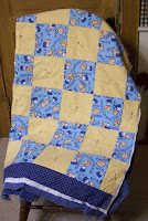blue and tan flannel quilt