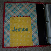 inside of notebook showing pocket with my name embroidered on it