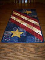 red, white and blue tablerunner that resembles our flag