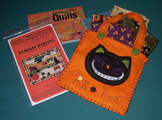 postcards, fall pattern and bag with fat quarters of fabric
