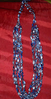 crocheted, blue, four strand  necklace
