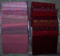 ten red and ten pink fat quarters of fabric