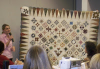 Edyta Sitar with her version of the Dear Jane quilt