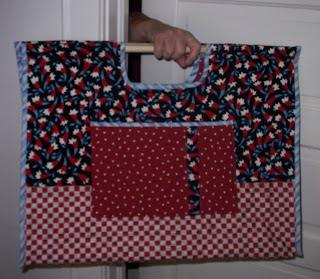 large carry all tote with wooden dowel handles made with ugly fabric for our guild challenge