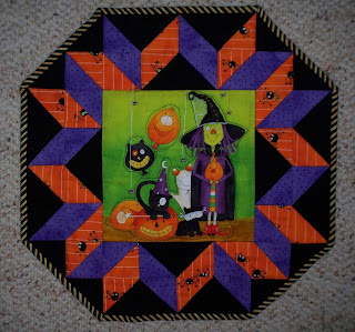 Halloween picture in center with pieced blocks around it makes this tabletopper