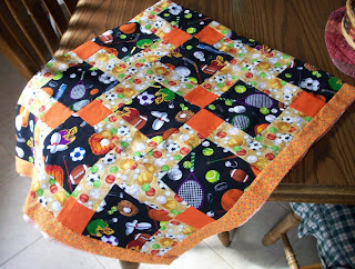 Disappearing Nine Patch quilt made with sports themed fabrics