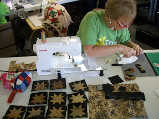 Connie working on her little star blocks using Jo Morton fabrics