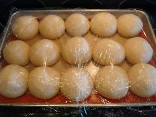rolls rising on a sheet pan