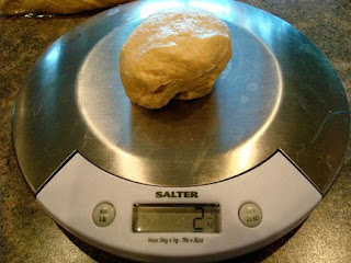 weighing a pice of dough on a food scale