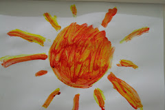 Handpainting Sun by Evan