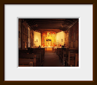 A filtered and soft warm glow lights the altar inside this ornately decorated Spanish mission in New Mexico.