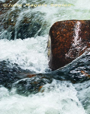 A swirling whirlpool of water and rocks.
