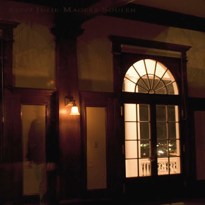 Dark room with window and ghost at historic Stanley Hotel