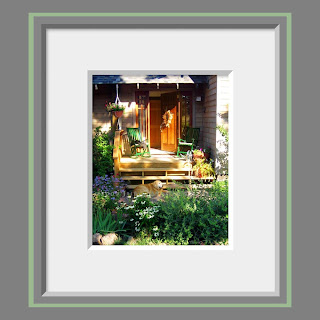 A photo of an inviting front porch next to a perennial garden full of summer flowers and a golden retriever dog basking in the warm light.