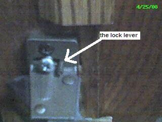 inside latch showing where to put a screw so it won't lock on its own