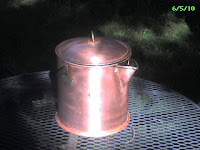 Shiny copper coffee pot after treatment.
