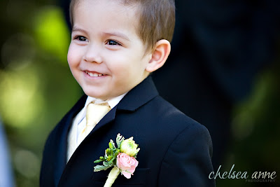 Cutie Pie Ringbearer With A Boutonniere Of Single Pink Rose And White Dahlia Bud