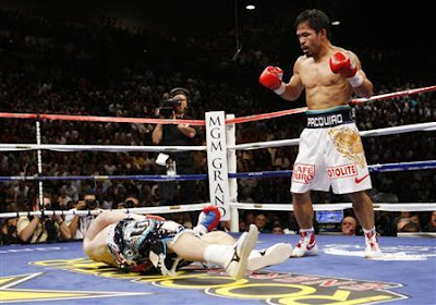 Pacman throws the knockout punch, left straight at the last 8 seconds of round 2