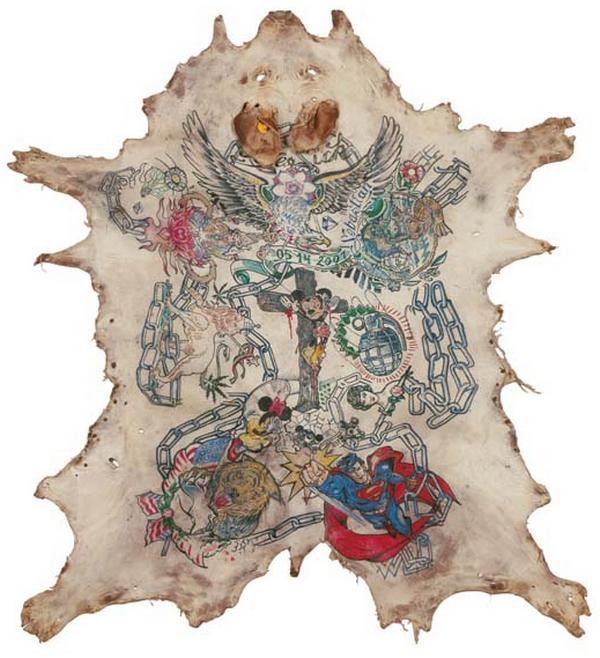 Belgian artist Wim Delvoye Tattooed Pigs