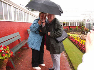 Ann and Jean laughing in the face of the rain