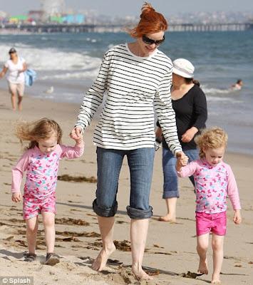 Marcia Cross on the beach in sailor shirt