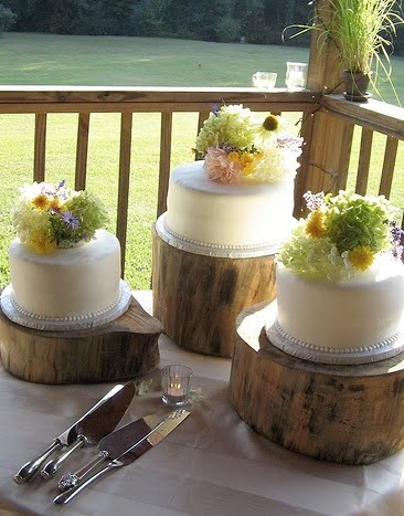 OnceWed has a fabulous DIY post on how to make a similar rustic cake stand