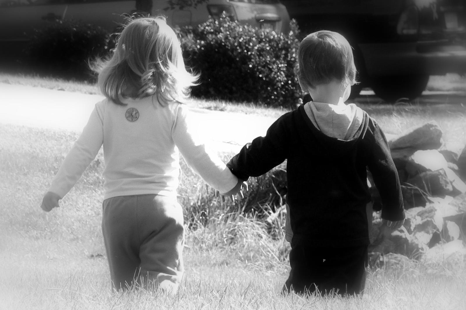 Boy and Girl Holding Hands Black White Image