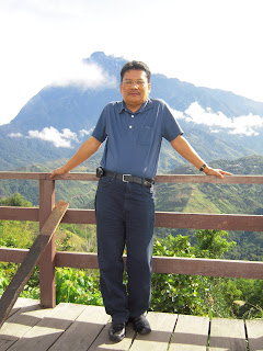 Mount Kinabalu at the back of Author