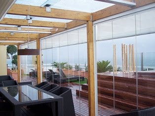 Estudio alvos interiorismo cerramientos de terrazas y - Cerramientos plegables de vidrio ...