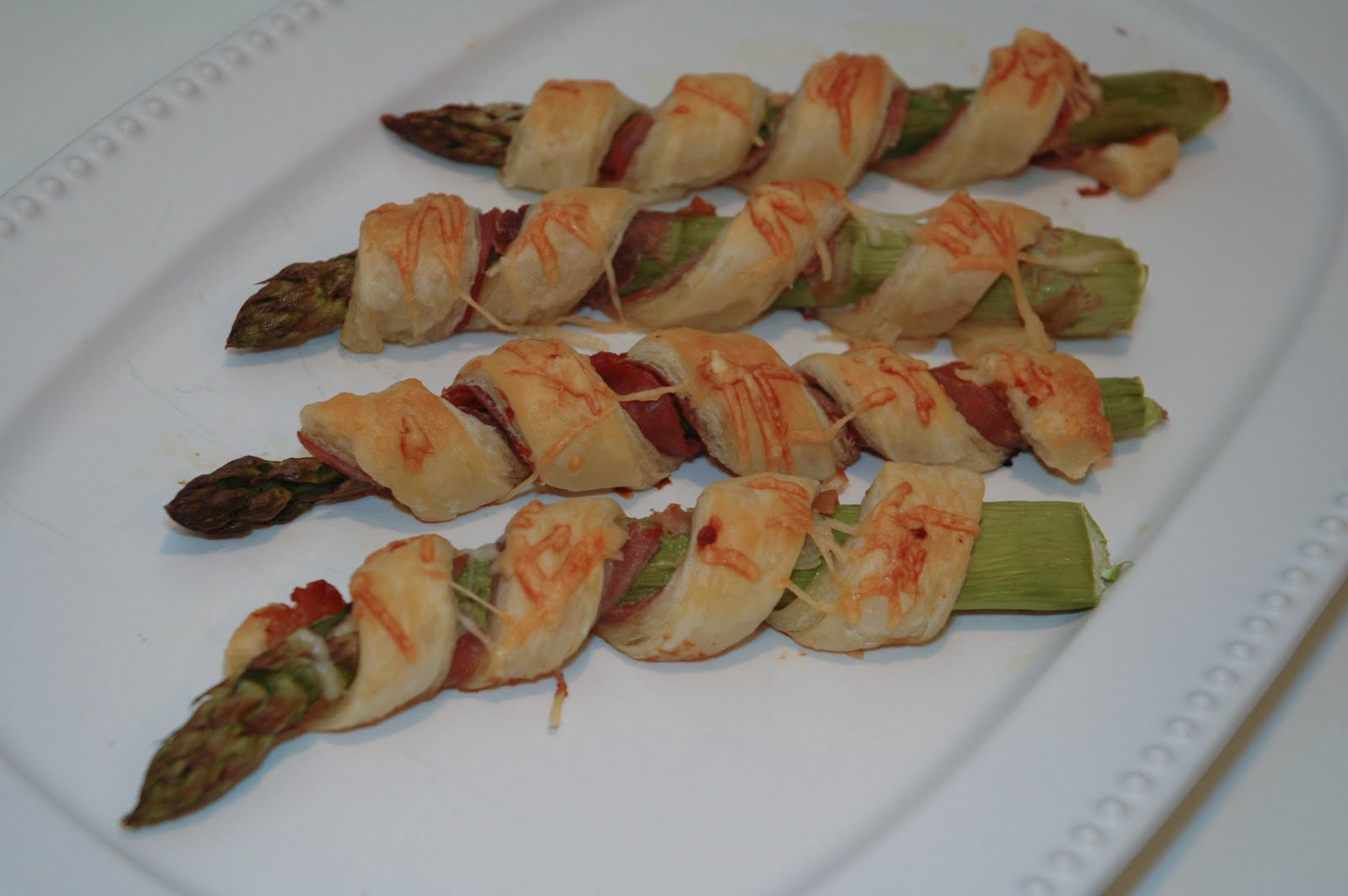 This is an easy and elegant recipe that wraps prosciutto and puff ...