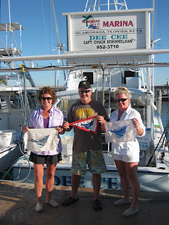 showing off sailfish flags