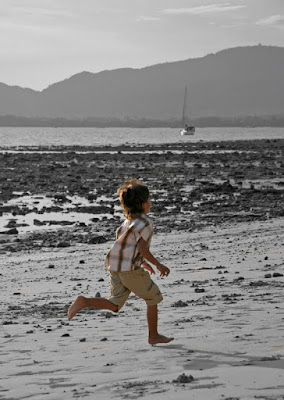 Running on the beach at Cape Panwa